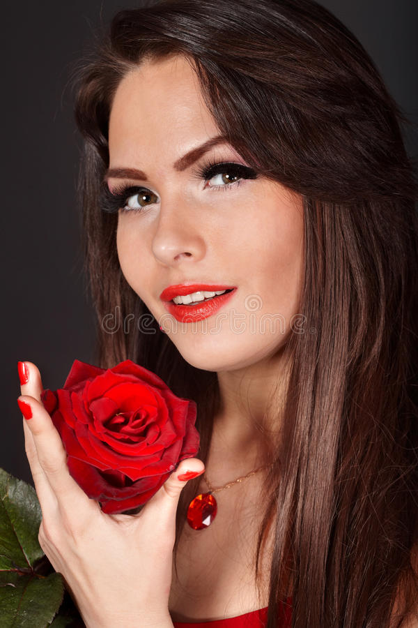 Girl with rose on red background. Valentines day. stock photos