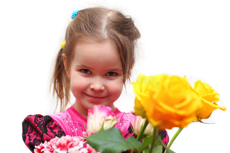 Girl with Roses. Smiling beautiful little girl giving a bouquet of roses stock photos