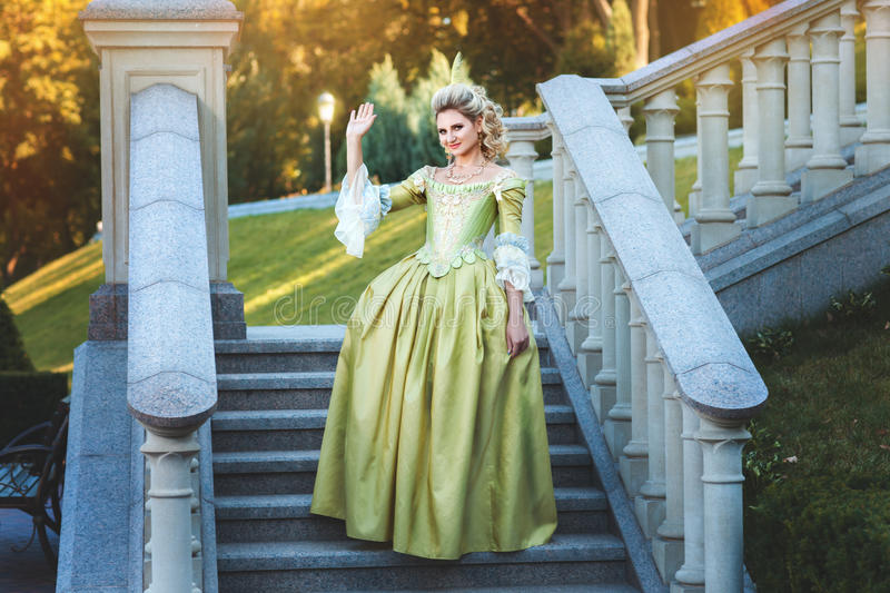 Girl royal dress standing steps of the palace. royalty free stock photos