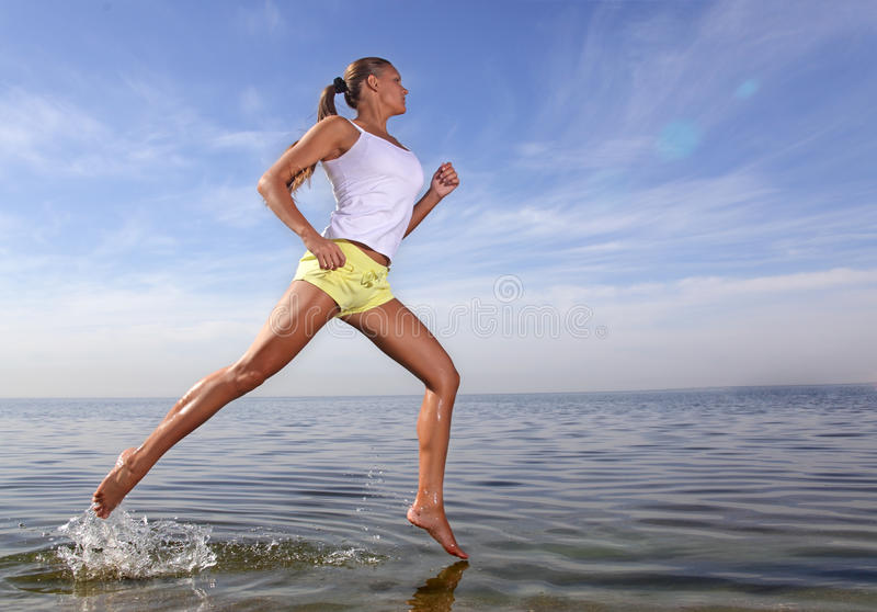 Girl run. Beauty girl run on beach stock photo