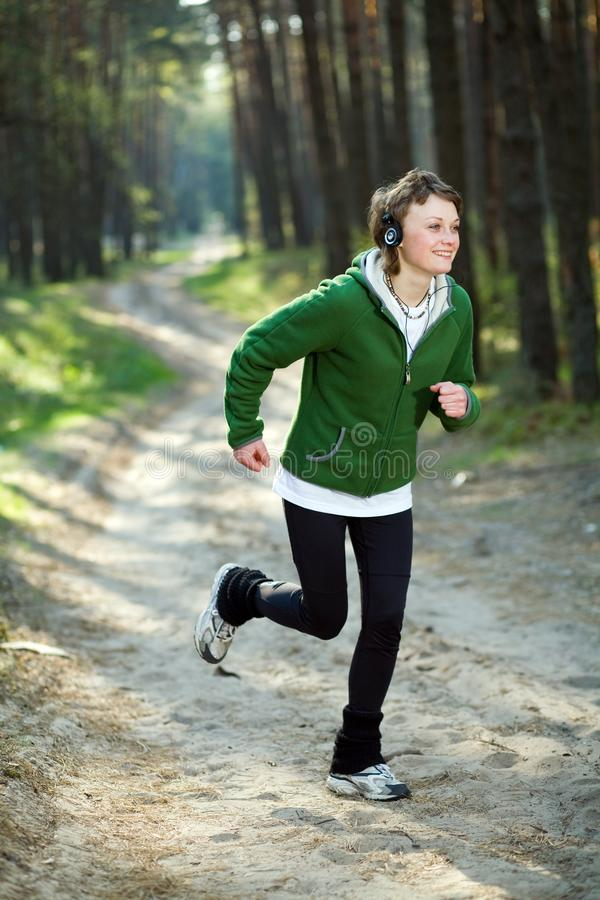 Free Girl Runner In The Forest Royalty Free Stock Image - 9754386