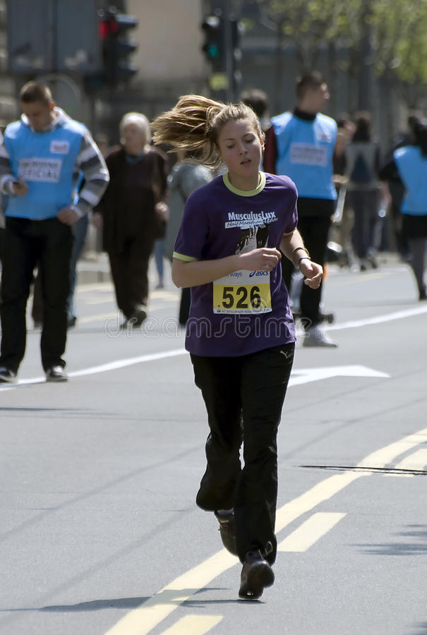 Girl runner near the finish line royalty free stock photography