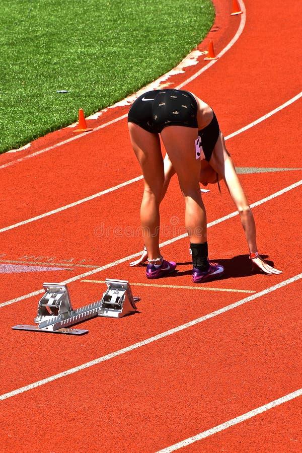 Girl runner stretching ham strings royalty free stock images