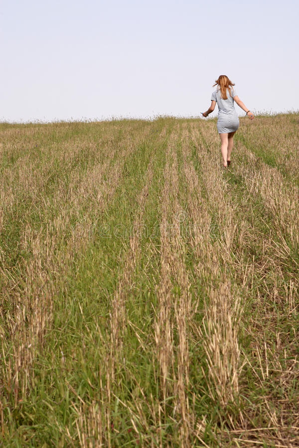 Girl running. On the field royalty free stock photo