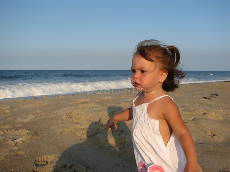 Girl running on beach stock photo