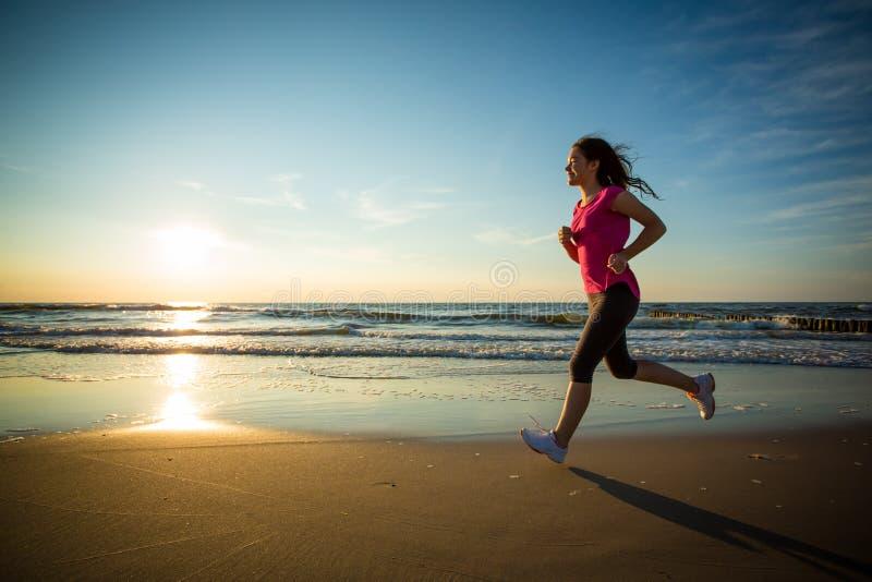Girl running on beach. Girl running, jumping on beach royalty free stock image