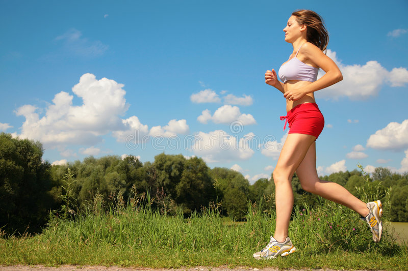 Girl running forest. Girl running in the forest royalty free stock photos