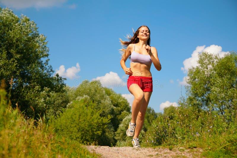 Girl running in forest. Summer stock photos