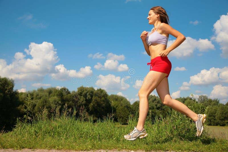 Girl running forest. Girl running in forest, summer stock photography