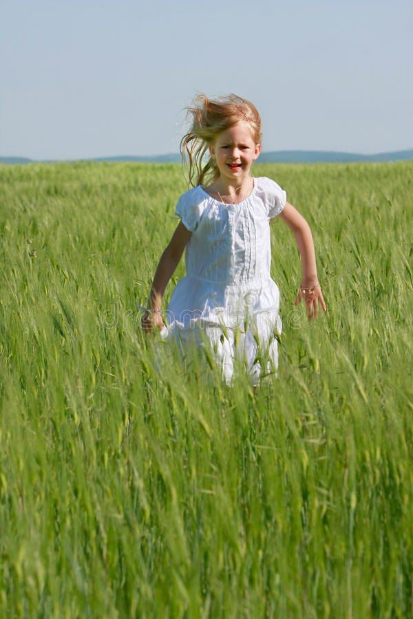 Download Girl Running In Green Grass Royalty Free Stock Photos - Image: 9512128