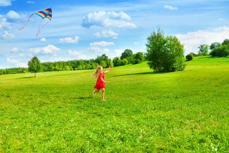 Girl running with kite royalty free stock photography