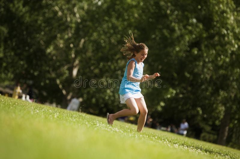 Download Girl Running In The Park Royalty Free Stock Image - Image: 17065086