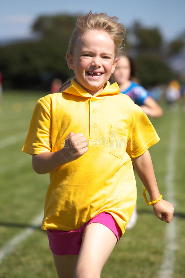Girl running in sports race. At school stock photo