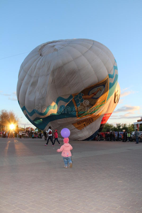 The girl running to a balloon stock photo