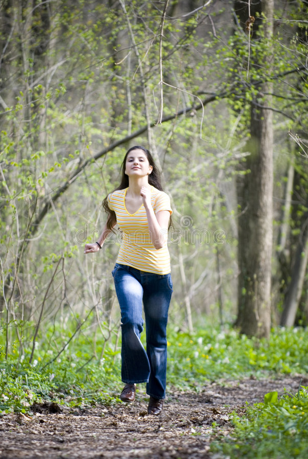 Girl running in woods royalty free stock photo
