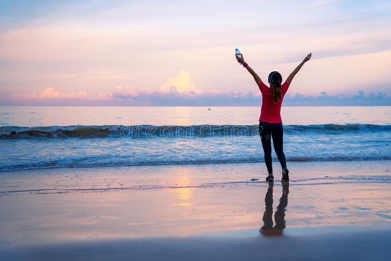 Girl running workout jogging on the beach in the morning. relax and happy with running on the sea. in summer. Girl relax Jogging exercise on the beach stock photography