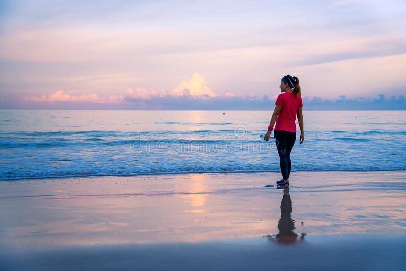 Girl running workout jogging on the beach in the morning. relax and happy with running on the sea. in summer. Girl relax Jogging exercise on the beach royalty free stock photos