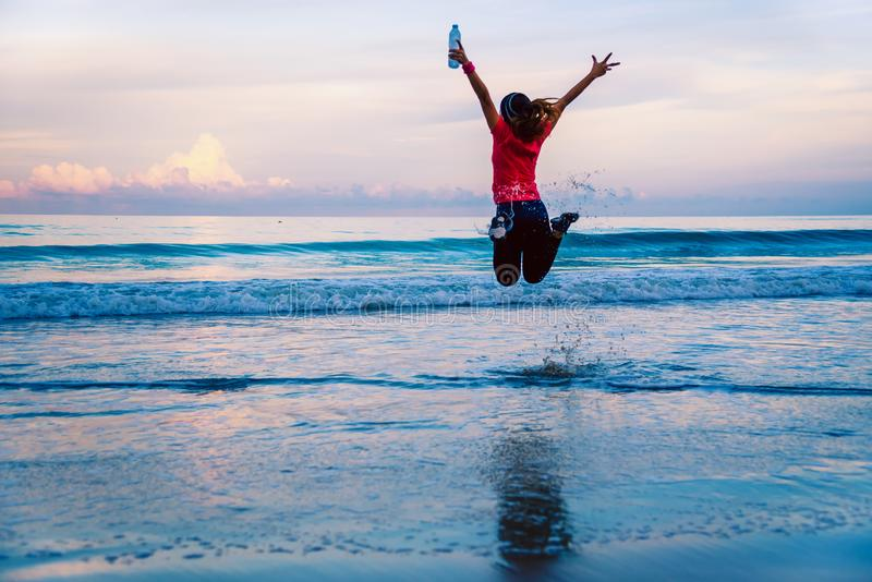 Girl running workout jogging on the beach in the morning. relax and happy with running on the sea. in summer. Girl running workout jogging on the beach in the royalty free stock image
