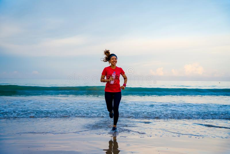 Girl running workout jogging on the beach in the morning. relax and happy with running on the sea. in summer stock images