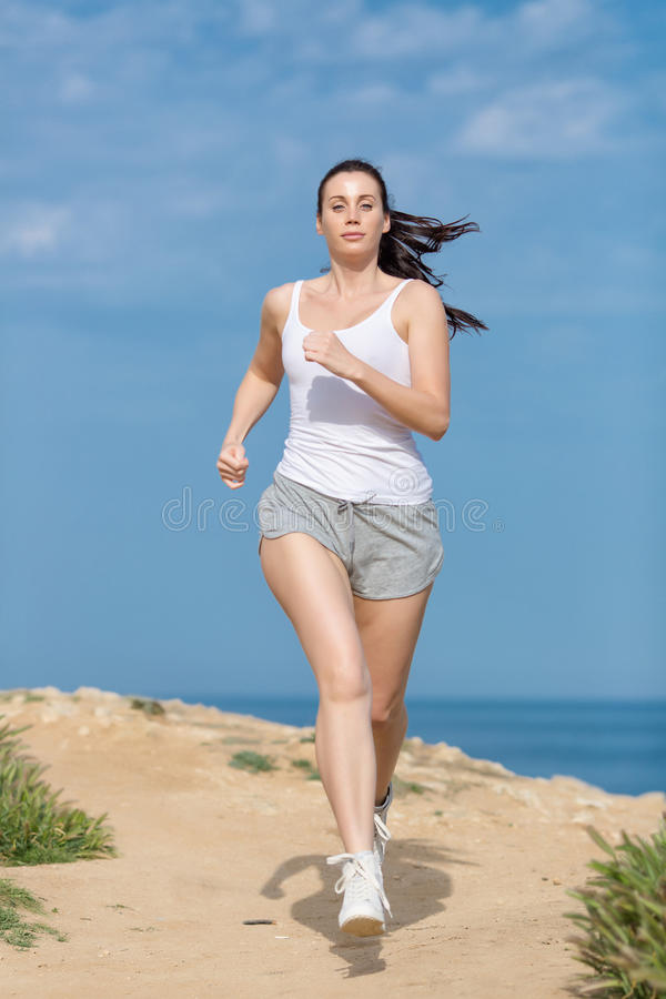 Download Girl runs along seashore stock photo. Image of ethnicity - 83706300