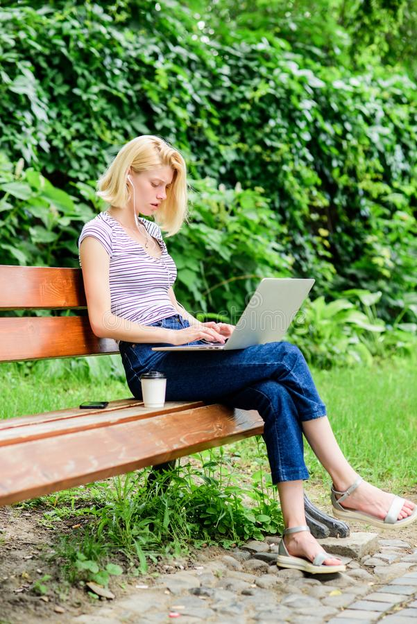 Girl runs her blog on notebook. woman drink coffee. Inspiration for blogging. modern woman with notebook blogging stock photo