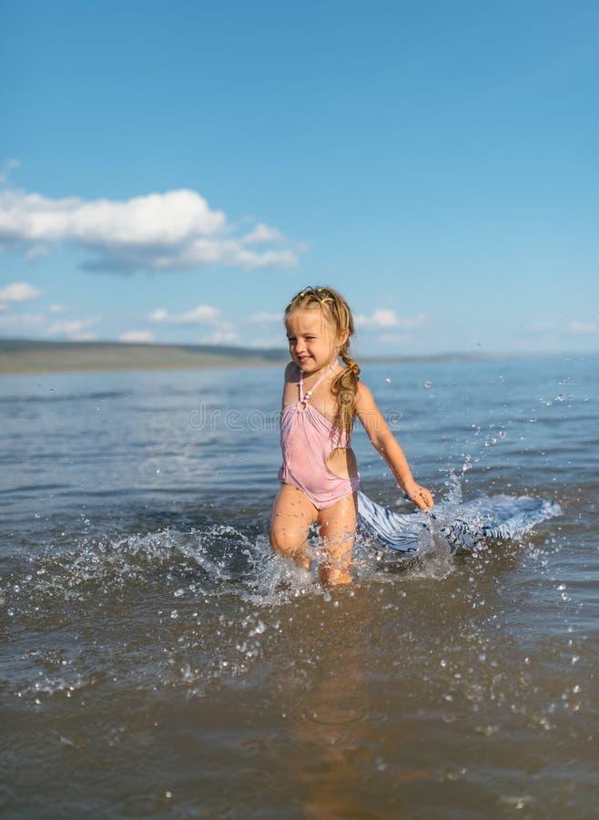 Girl runs on water stock photos