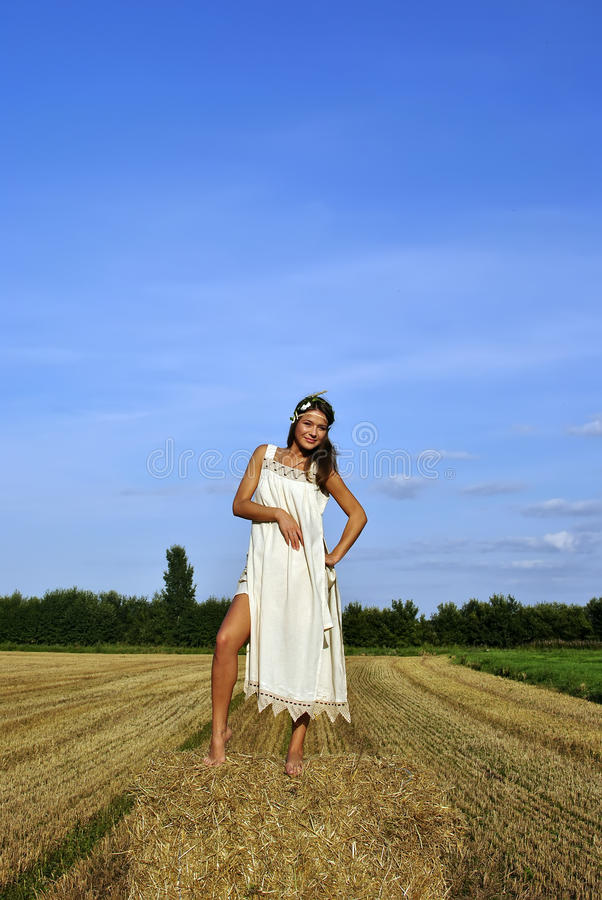 Girl In A Rural Clothing Standing On The Haystack Royalty Free Stock Photos