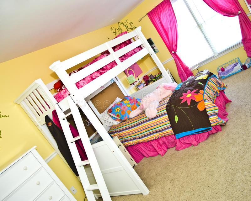 Girl's Bedroom with Bunk Bed. A colorful girl's room with double and single bunk beds royalty free stock photos