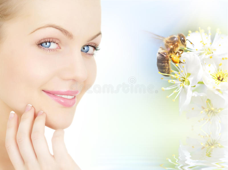 Girl's face and a bee stock photo