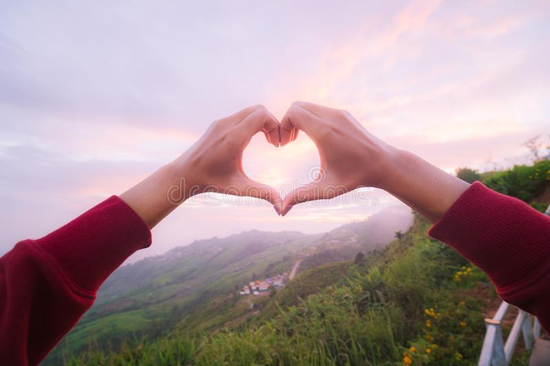 Girls Hand Both Hands Doing A Heart Shaped Symbol Stock Photo