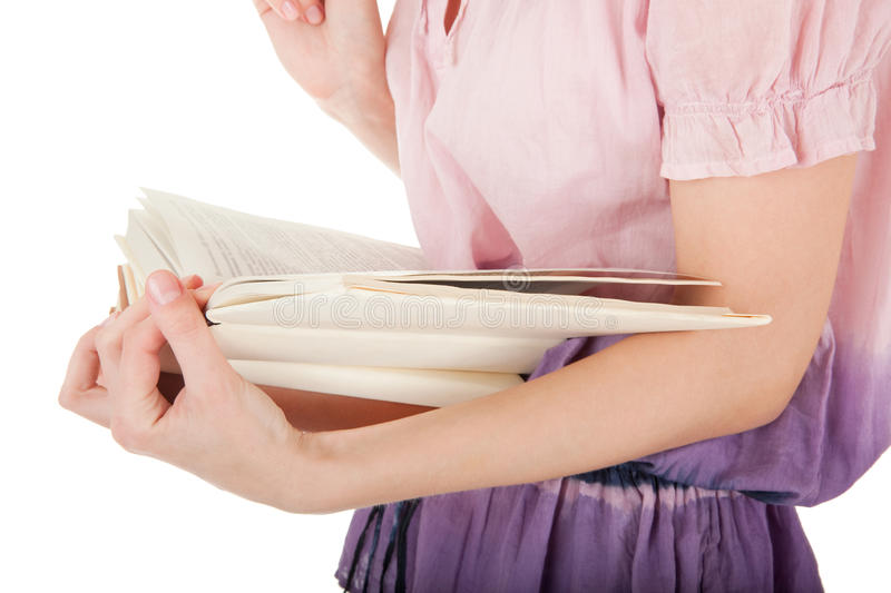 Girl's hand holding a book stock photo