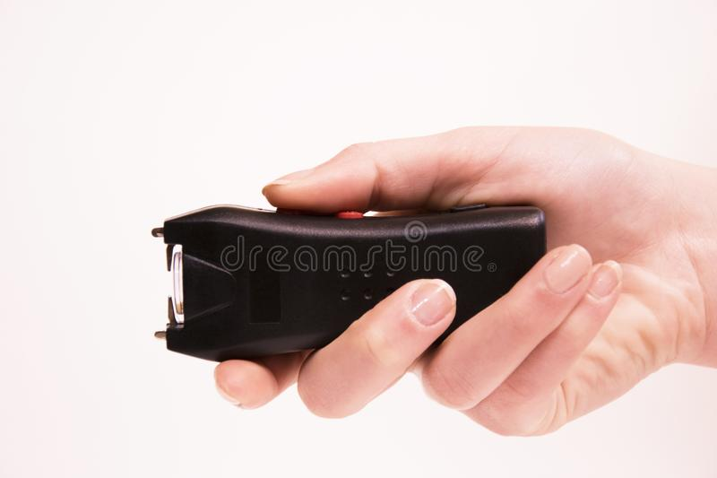 The girl`s hand holds an Electroshock stock photography