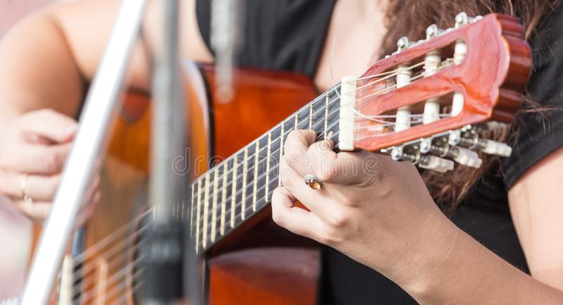 Girl`s hand playing guitar royalty free stock photos