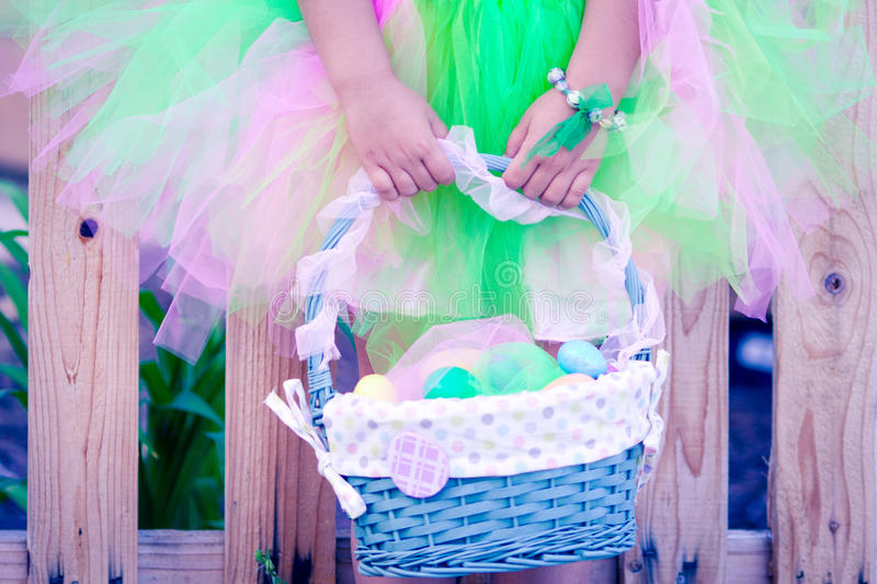 Girl's hands holding an Easter basket royalty free stock photos