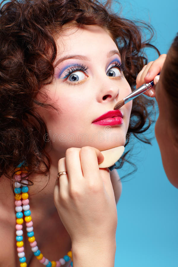 Girl's make up. Portrait of beautiful curly brunette girl make up stock image
