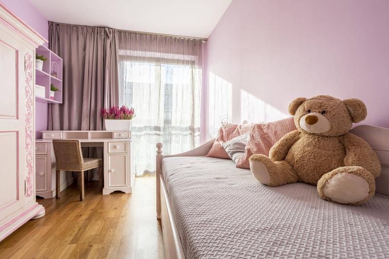 Girl`s pink bedroom royalty free stock photography