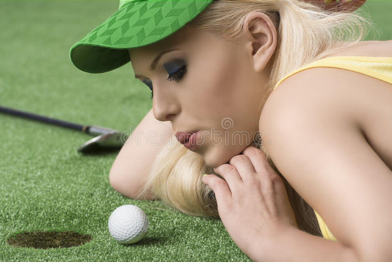 Girl's playing with golf ball and hand under royalty free stock images