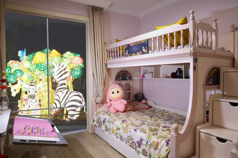 Princess bedroom with park view. Girl`s princess theme bedroom with fashion design, wall with wall paper, bunk bed and other decorations. Paper lamp wonderland stock images