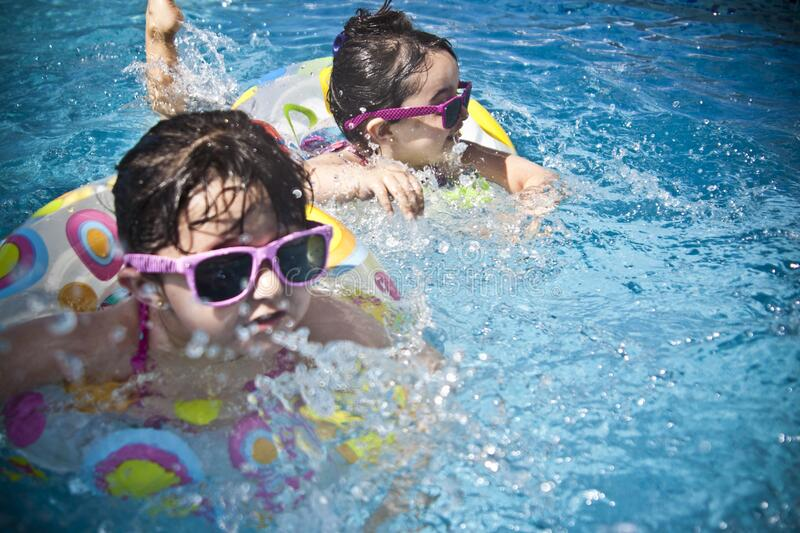 2 Girl's Swimming during Daytime stock photography