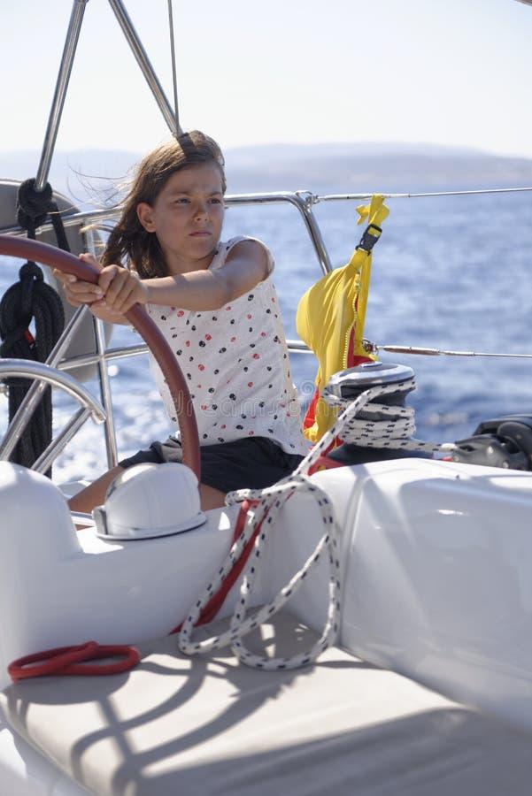 Girl sailing boat stock photo