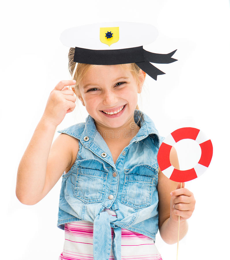 Girl in sailor hat. Cute little girl in sailor hat royalty free stock photo