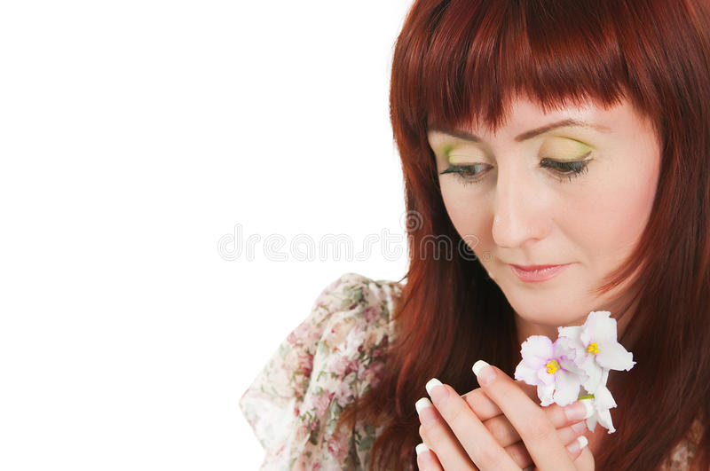 Download The Girl With A Saintpaulia Stock Photo - Image: 31226542