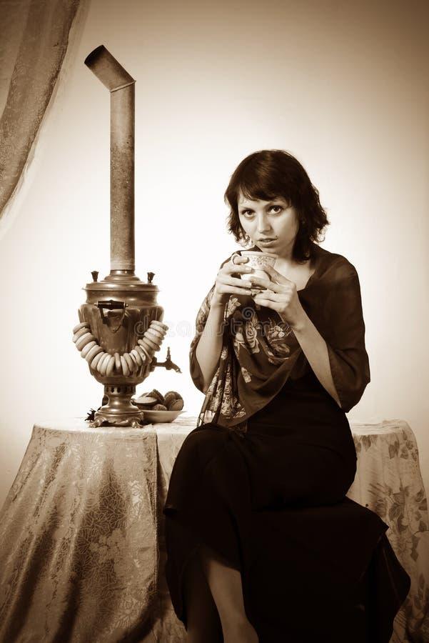 Girl with samovar. Vintage stock photos