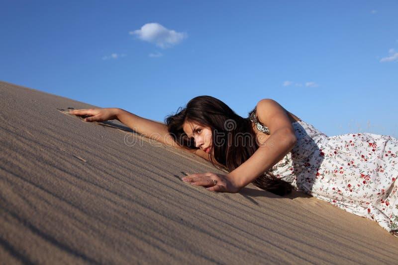 Girl in sand stock photo