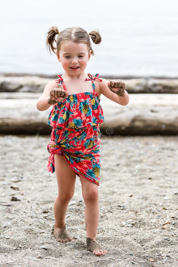 Girl with sand on her hands stock photos