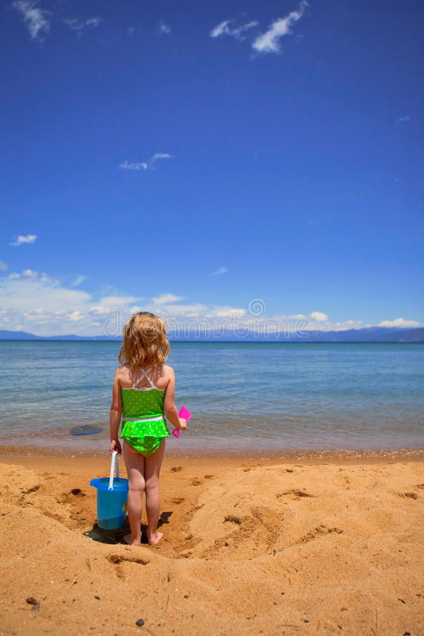 Girl in the sand at the Lake royalty free stock photos