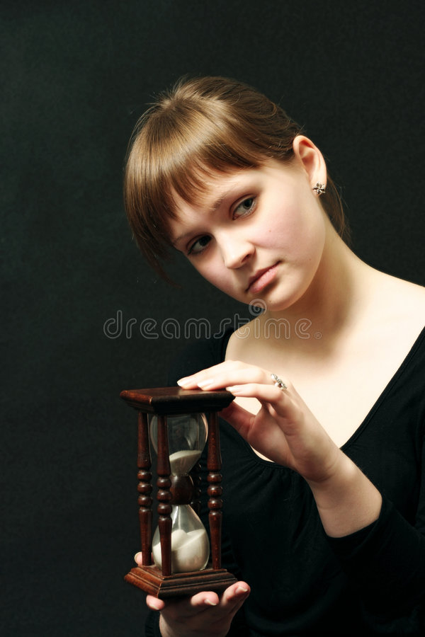 Girl with a sandglasses royalty free stock photos