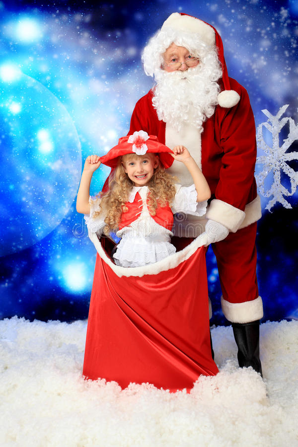 Girl and santa stock images