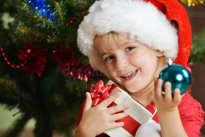 Download Girl  in santa cap stock image. Image of adorable, green - 27285315