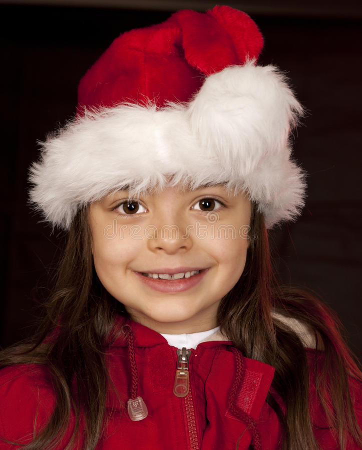 Girl Santa Claus. Girl in red hat on black background stock images
